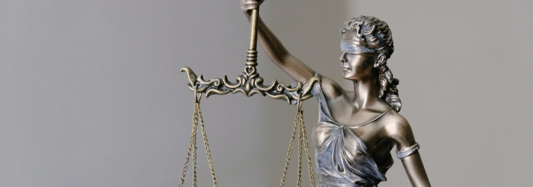 Statue of blinded Justice holding scales.